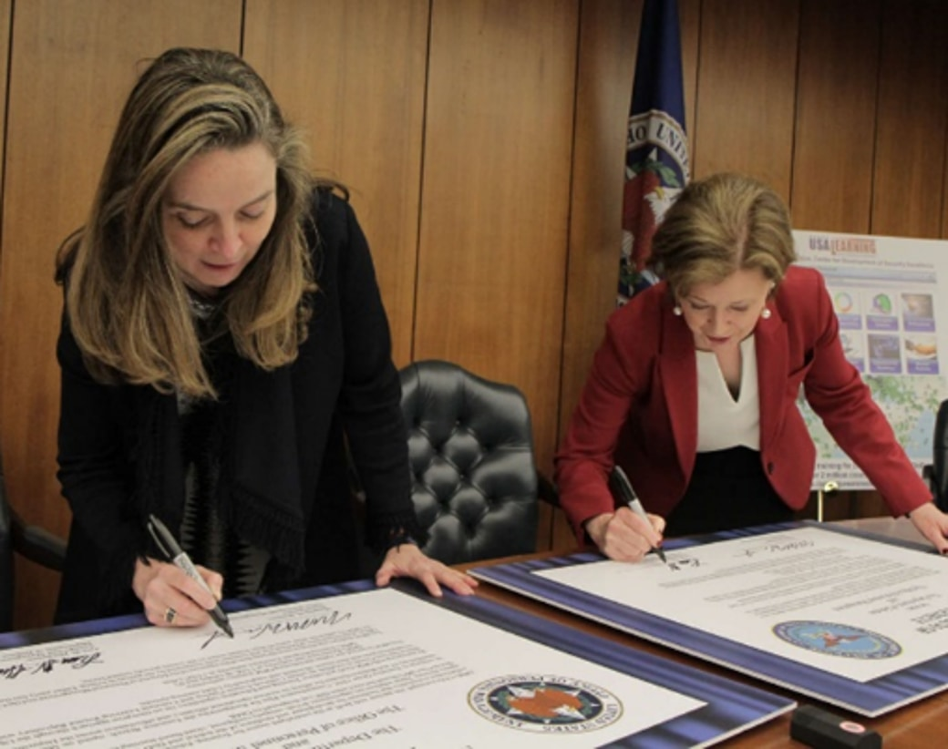 In March 2019, Margaret Weichert (left) and Lisa W. Hershman (right) signed an OPM-DoD memorandum of agreement for DoD enterprise digital learning reform